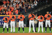 The Houston Astros stand for the national anthem prior to Game Seven of the 2019 World Series against the Washington Nationals at Minute Maid Park on October 30, 2019 in Houston, Texas.