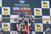 (L-R) Marco Melandri of Italy and BMW Motorrad GoldBet SBK, Tom Sykes of Great Britain and Kawasaki Racing Team and Sylvain Guintoli of France and Aprilia Racing Team celebrate on the podium at the end of Race 1 of the World Superbikes during round five of 2013 Superbikes FIM World Championship at Donington Park on May 26, 2013 in Castle Donington, England.