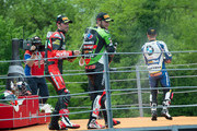 (L-R)  Eugene Laverty of Ireland and Aprilia Racing Team, Tom Sykes of Great Britain and Kawasaki Racing Team and  Marco Melandri of Italy and BMW Motorrad GoldBet SBK celebrate and spray champagne on the podium at the end of round four of the 2013 Superbike FIM World Championship at Autodromo di Monza on May 12, 2013 in Monza, Italy.
