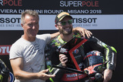 Tom Sykes of Great Britain and KAWASAKI RACING TEAM WorldSBK celebrates  the Superpole in Superbike with Pierfrancesco Chili (L) of Italy during the WorldSBK Riviera di Rimini - Qualifying on July 7, 2018 in Misano Adriatico, Italy.