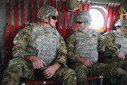 U.S. Army Sgt. (Ret.) Daniel Harrison (L) of Atlanta, Texas, and Sgt. (Ret.) Noah Galloway of Birmingham, Alabama sit onboard a helicopter during a flight to Forward Operating Base (FOB) Fenty on March 12, 2014 near Bagram, Afghanistan. They were touring Afghanistan with the Troops First Operation Proper Exit program. The program brings wounded servicemen back to Iraq and Afghanistan to help them come to terms with their injuries.
