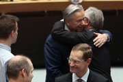 Michael Mueller, designated mayor of the city of Berlin (SPD) (C), is congratulated during a plenary session of the Berlin state parliament or Landtag of Berlin as Outgoing Berlin Mayor Klaus Wowereit (SPD, top) hugs a well-wisher in the Abgeordnetenhaus, or the city-state's parliament building, on December 11, 2014 in Berlin, Germany. Mueller, formerly Berlin's development senator, is the capital's next mayor, taking over from incumbent Klaus Wowereit, who had announced his resignation in August after the city failed to finish building its new airport even years after its scheduled opening. While outgoing Wowereit, who ran the city for over 13 years, was seen as a driving force behind the city's perceived party-oriented culture, famous for describing the capital as 'poor but sexy,' Mueller is seen as being more pragmatic.