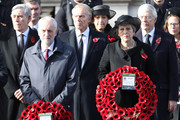 Leader of the Labour Party Jeremy Corbyn and British Prime Minister Theresa May hold wreaths during the annual Remembrance Sunday memorial on November 11, 2018 in London, England. The armistice ending the First World War between the Allies and Germany was signed at Compiègne, France on eleventh hour of the eleventh day of the eleventh month - 11am on the 11th November 1918. This day is commemorated as Remembrance Day with special attention being paid for this year's centenary.