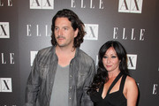 Kurt Iswarienko and Shannen Doherty arrive to A|X Armani Exchange and ELLE's Joe Zee's 'Disco Glam' soiree evening at A|X Robertson Store on May 25, 2010 in Los Angeles, California.