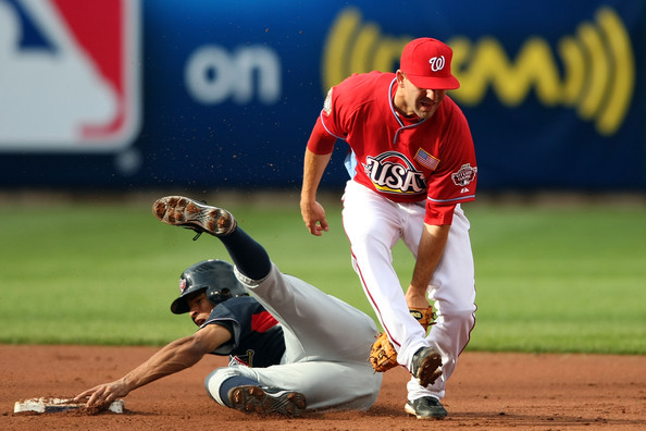 Danny Espinosa U.S. Futures All-Star Danny Espinosa of the Washington National fails to tag out World Futures All-Star Tyson Gillies of the Seattle Mariners as he steals second base during the 2009 XM All-Star Futures Game at Busch Stadium on July 12, 2009 the in St. Louis, Missouri.