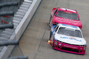 Spencer Gallagher, driver of the #23 Allegiant Chevrolet, leads Elliott Sadler, driver of the #1 OneMain Financial Chevrolet, during the NASCAR Xfinity Series Bar Harbor 200 presented by Sea Watch International at Dover International Speedway on October 6, 2018 in Dover, Delaware.