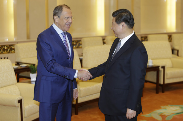 Xi Jinping Russian Foreign Minister Sergei Lavrov (L) shakes hands with China's President Xi Jinping at the Great Hall of the People on April 15, 2014 in Beijing, China.  Lavrov is on a one-day visit to China.