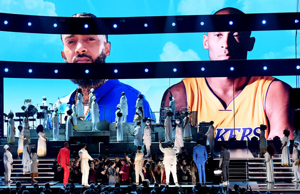 62nd Annual GRAMMY Awards - Show [images,performance,stage,display device,concert,musical,event,pop music,music artist,performing arts,technology,nipsey hussle,kobe bryant,kirk franklin,john legend,dj khaled,screen,l-r,annual grammy awards,show,nipsey hussle,grammy awards,hip hop music,rapper,artist,grammy award for best rap performance,the marathon continues,the recording academy,iheartradio,dj khaled]