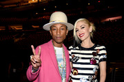 Pharrell Williams and Gwen Stefani pose backstage at iHeartRadio Jingle Ball 2014, hosted by Z100 New York and presented by Goldfish Puffs at Madison Square Garden on December 12, 2014 in New York City.