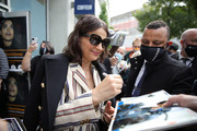 Juliette Binoche signs autographs upon her arrival for the ZFF Masters during the 16th Zurich Film Festival at Filmpodium on October 01, 2020 in Zurich, Switzerland.