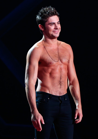 MTV Movie Awards Show [that awkward moment,barechestedness,man,model,male,muscle,fashion model,performance,chin,standing,human body,zac efron,mtv movie awards,award,best shirtless performance,california,los angeles,nokia theatre l.a. live,show]