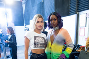 (L-R) Hailey Baldwin and Justine Skye pose backstage at the Zadig & Voltaire fashion show during New York Fashion Week at Cedar Lake Studios on February 12, 2018 in New York City.