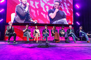"""Grae Drake, Ruben Fleischer , Zoey Deutch, Jesse Eisenberg, Rosario Dawson, Avan Jogia, Paul Wernick  and Rhett Reese on stage at a """"Zombieland 2"""" Panel and Surprise Screening at Los Angeles Convention Center on October 12, 2019 in Los Angeles, California."""