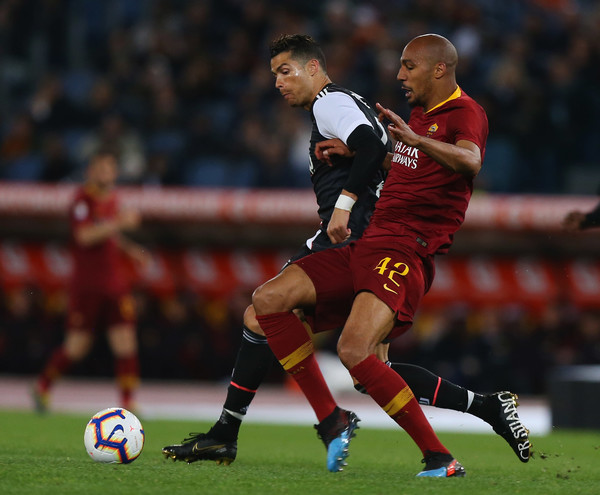 AS Roma vs. Juventus - Serie A [player,sports,soccer player,sports equipment,football player,team sport,ball game,football,sport venue,soccer,as roma,juventus,serie a,serie a match between as roma,rome,italy,steven nzonzi of as roma,cristiano ronaldo of juventus,stadio olimpico]