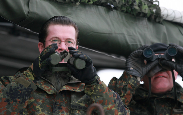Karl-theodor Zu Guttenberg German Defence Minister Karl-Theodor zu Guttenberg tries to watch through shuttered binoculars during a visit to the Bundeswehr military training grounds on January 15, 2010 in Letzlingen, Germany. The soldiers of the 22nd Contingent are currently training for the upcoming ISAF mission. The German ISAF military deployment in Afghanistan has become a political headache for zu Guttenberg, following a German-ordered bombing of a Taliban hijacked gasoline tanker that killed many civilians and an overall policy that has left many German politicians and the German public wondering when the Bundeswehr soldiers will ever complete their mission.