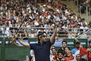 A fan imitates Roger Federer before an exhibition game between Alexander Zverev and Roger Federer at Arena Parque Roca on November 20, 2019 in Buenos Aires, Argentina.