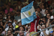 A fan of Roger Federer of Switzerland shows a flag of Argentina in the stands during an exhibition game between Alexander Zverev and Roger Federer at Arena Parque Roca on November 20, 2019 in Buenos Aires, Argentina.