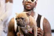 2 Chainz and his dog Trappy speak during a press conference at adidas Creates 747 Warehouse St., an event in basketball culture, on February 16, 2018 in Los Angeles, California.