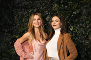 Madison Grace and Victoria Justice attend the alice + olivia by Stacey Bendet Fall 2020 presentation at Highline Stages on February 10, 2020 in New York City.