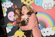 Caroline D'Amore (L) and Paris Jackson attend the alice + olivia by Stacey Bendet x FriendsWithYou Collection LA launch party at the Hollywood Athletic Club on November 07, 2019 in Hollywood, California.