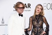 Peter Dundas and  Natasha Poly arrive at amfAR's 23rd Cinema Against AIDS Gala at Hotel du Cap-Eden-Roc on May 19, 2016 in Cap d'Antibes, France.