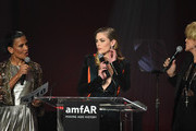 (L-R) Chairman, Sotheby's West Coast Andrea Fiuczynski and actors Jaime King and Sharon Stone speak onstage during amfAR's Inspiration Gala Los Angeles at Milk Studios on October 29, 2015 in Hollywood, California.
