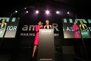 Sotheby's Senior Vice President Chairman West Coast Andrea Fiuczynski (L) and amfAR Global Fundraising Chairman Sharon Stone speak onstage during amfAR LA Inspiration Gala honoring Tom Ford at Milk Studios on October 29, 2014 in Hollywood, California.