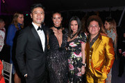 (L-R) CFO at AMTD Philip Yau, tv personality/model Heidi Klum, guest and artist Romero Britto attend the amfAR Gala Los Angeles 2017 at Ron Burkle's Green Acres Estate on October 13, 2017 in Beverly Hills, California.