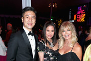 CFO at AMTD Philip Yau (L) and actor Goldie Hawn (R) attend the amfAR Gala Los Angeles 2017 at Ron Burkle's Green Acres Estate on October 13, 2017 in Beverly Hills, California.