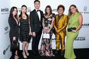CFO at AMTD Group Philip Yau (L), artist Romero Britto (R) and guests attend the amfAR Gala Los Angeles 2017 at Ron Burkle's Green Acres Estate on October 13, 2017 in Beverly Hills, California.