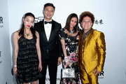 (2nd L-R) CFO at AMTD Group Philip Yau, guest and artist Romero Britto attend the amfAR Gala Los Angeles 2017 at Ron Burkle's Green Acres Estate on October 13, 2017 in Beverly Hills, California.