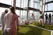 (L-R) Tommy Haas of Germany, Monica Puig of Puerto Rico, Elina Svitolina of Ukraine and former Wimbledon Champion Pat Cash play tennis during an ellesse photo call at The View from The Shard on June 25, 2015 in London, England. ellese created an Astroturf tennis court 776ft (236.5 metres) up in the air on Level 69 of The Shard, which is the tallest building in Western Europe.