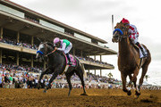 Collected #2, ridden by Martin Garcia holds off the late charge of Arrogate #8, ridden by Mike Smith to win theTVG Pacific Classic at Del Mar Thoroughbred Club, on August 19, 2017 in Del Mar, California.