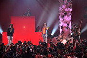 (L-R) Quavo, Takeoff, and Offset of Migos perform onstage at iHeartRadio album release party with Migos presented by MAGNUM Large Size Condoms at iHeartRadio Theater on January 22, 2018 in Burbank, California.