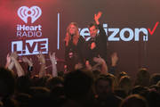 Molly and Harms speak on stage during iHeartRadio LIVE and Verizon bring you Fall Out Boy in Seattle on November 11, 2019 in Seattle, Washington.