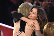 Recording artists Taylor Swift (L) and Selena Gomez hug during the iHeartRadio Music Awards at The Forum on April 3, 2016 in Inglewood, California.