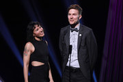 Matt Johnson (L), and Kim Schifino speak onstage during the 2019 iHeartRadio Podcast Awards Presented By Capital One at iHeartRadio Theater on January 18, 2019 in Burbank, California.