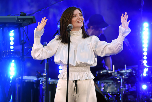 Lorde kept it modest and girly in a long-sleeve, high-neck peasant blouse with a smocked yoke and waist at the iHeartRadio Secret Sessions.
