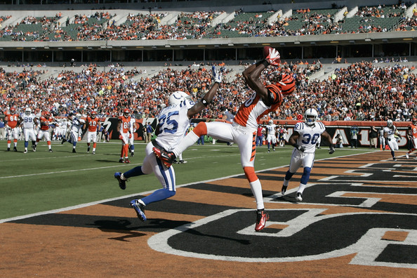 A.j. Green A.J.Green #18 of the Cincinnati Bengals makes a touchdown catch against Jerraud Powers #25 of the Indianapolis Colts during their game at Paul Brown Stadium on October 16, 2011 in Cincinnati, Ohio.