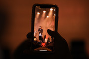 A fan records a video on a phone as Louis Tomlinson performs onstage during the z100 All Access Lounge presented by Poland Spring Pre-Show at Pier 36 on December 13, 2019 in New York City.
