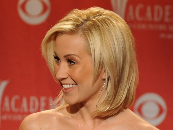 hairstyle that really suits her faceshape: a medium-length layered bob.
