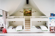Bunk beds and shelving for books in a children's bedroom