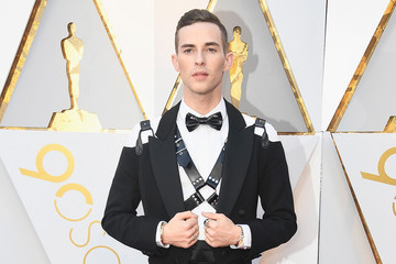 Adam Rippon Continues His Fabulous Wave Of Disruption By Sporting An S&M Harness To The Oscars