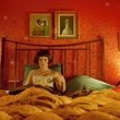 The dog and duck paintings in Amelie's room are by Michael Sowa.