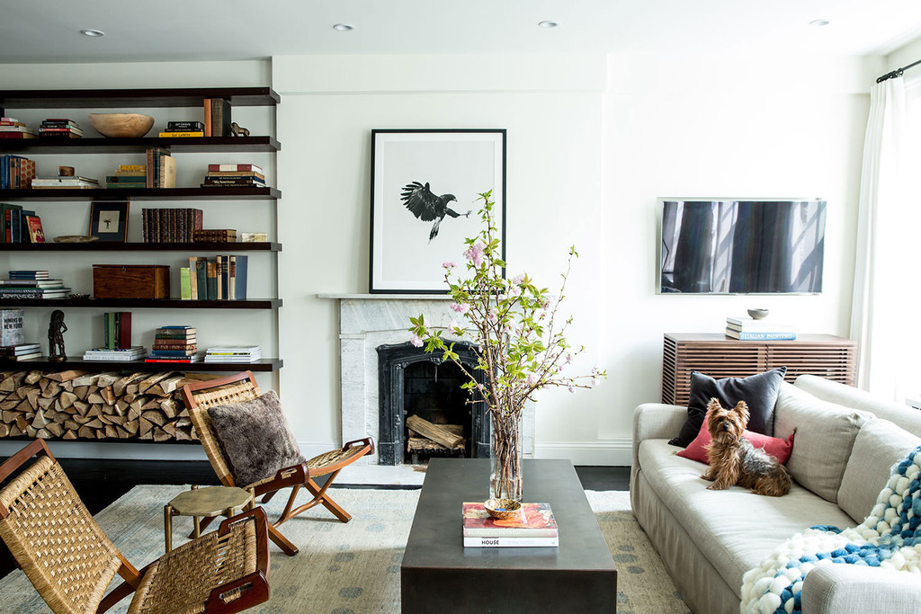 Open shelving, a classic hearth, and a subdued color palette give Christina and Trevor Winstead's apartment a timeless feel. | Lonny.com