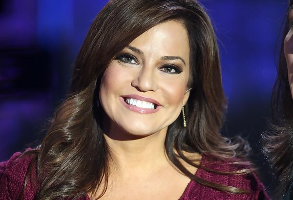 See pictures of Robin Meade, her husband Tim, (not