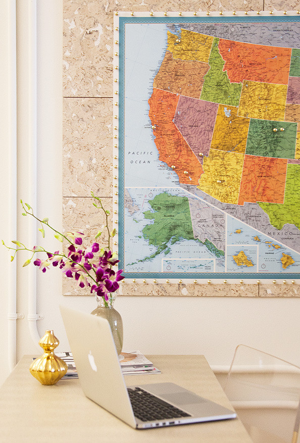 Lining the walls with<em> Blizzard</em> cork tiles by Amcork is a design trick that's both functional and decorative.
