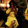 Adriana Lima gets her hair done.