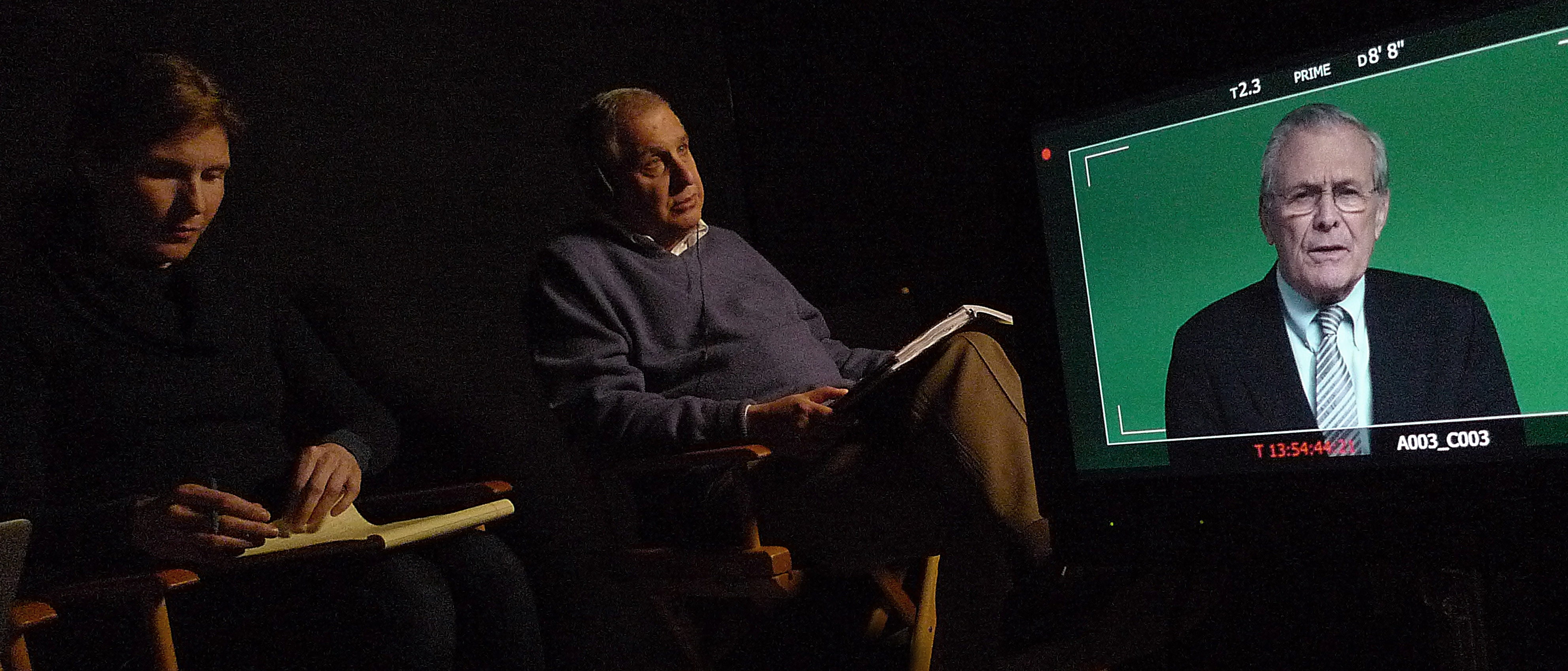 Errol Morris (C) interviews Donald Rumsfeld (R) using his Interrotron device. (RADiUS-TWC)