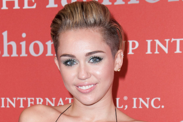 Miley Cyrus Plays With Wigs, Ralph Lauren's Olympic Gear Debuts, and More